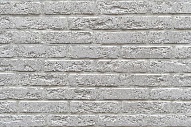 Wall made of white decorative brick