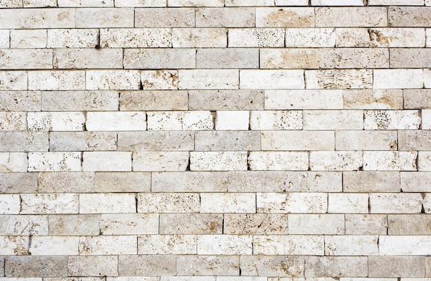 Wall made with bricks of white marble texture background