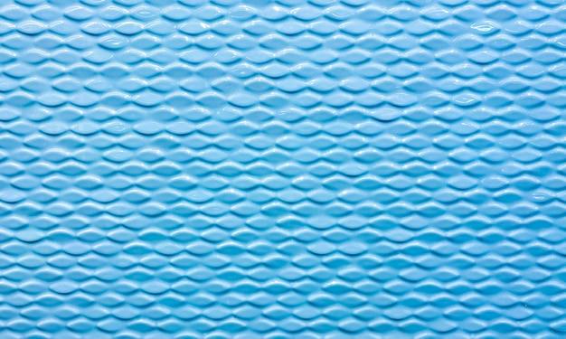 織り目加工の波とセラミックタイルの壁。青い色のタイル。背景、テクスチャ