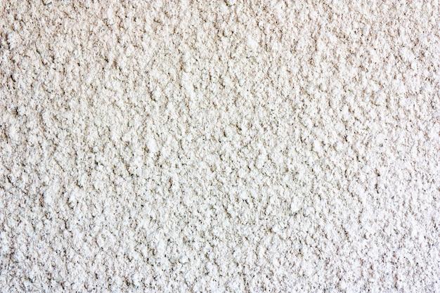 灰色の古いコンクリートの壁の壁デザイナーの壁のための白、灰色の古典的なテクスチャ。粗い照明面。しっくいが付いている具体的な壁。灰色のコンクリート。コンクリートコート