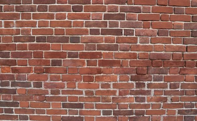 Стена из старого красного кирпича. кирпичный фон. текстура