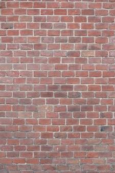 Стены из красного кирпича. шаблон. фон. макет. вертикальная рама