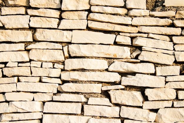 石の壁。石のスラブ。テクスチャ背景として使用できます