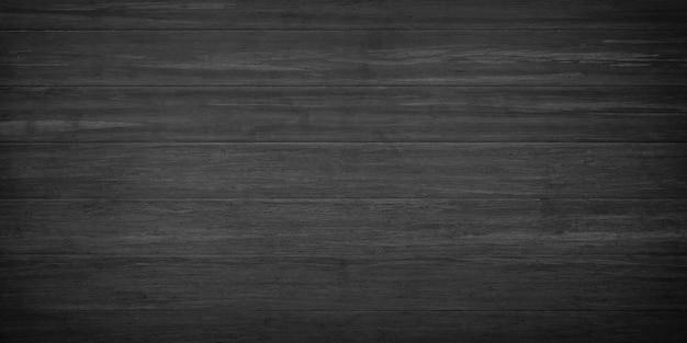 木の板で作られた壁またはテーブル。黒い木の質感の背景