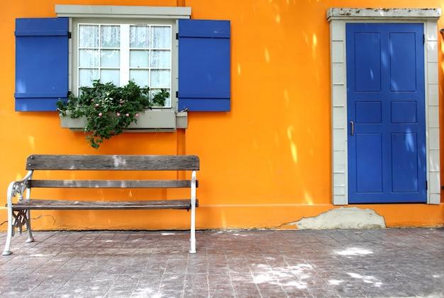 Wall orange with blue door and window