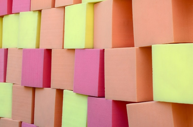 Wall of paralon soft cubes in dry pool, trampoline in the childrens center