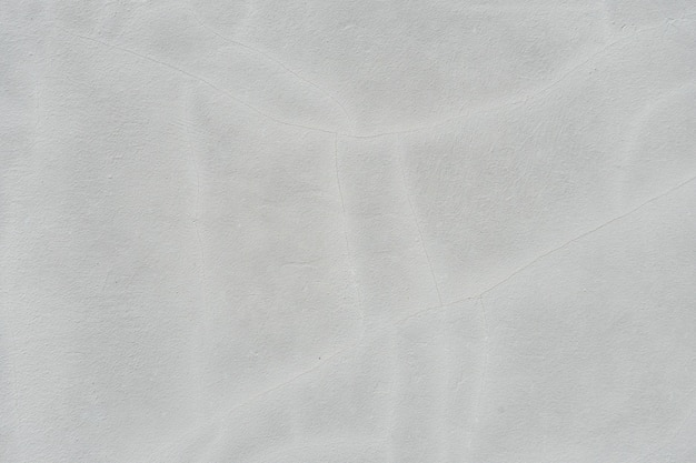 Поверхность стены с трещинами и шелушащейся краской текстуры фона. бетонная стена текстуры с замазкой.