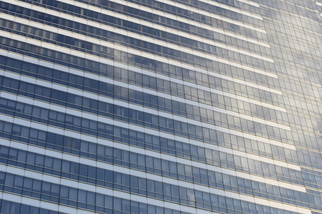 Wall of tall building or glass of skyscraper.