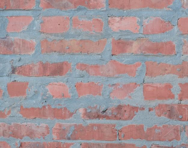 Предпосылка текстуры стены из красного кирпича и бетона.