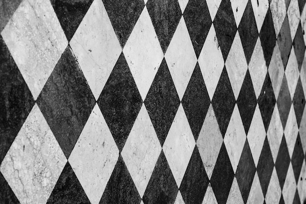 Wall with black and white tiles