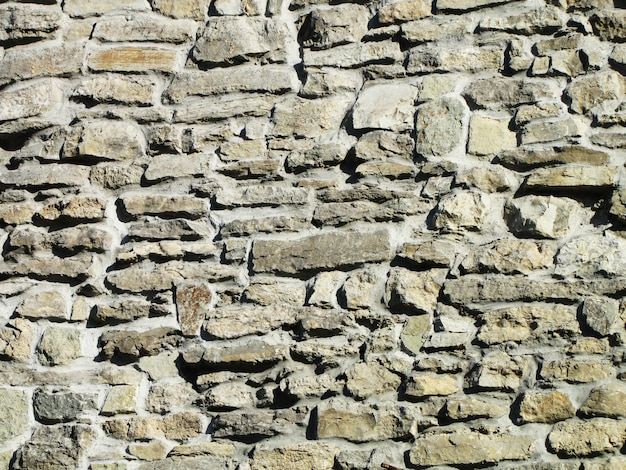 Wall with old masonry on a clear day