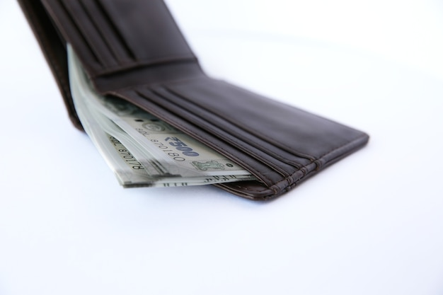 Wallet with money isolated on white.