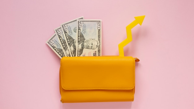 Wallet with money on table