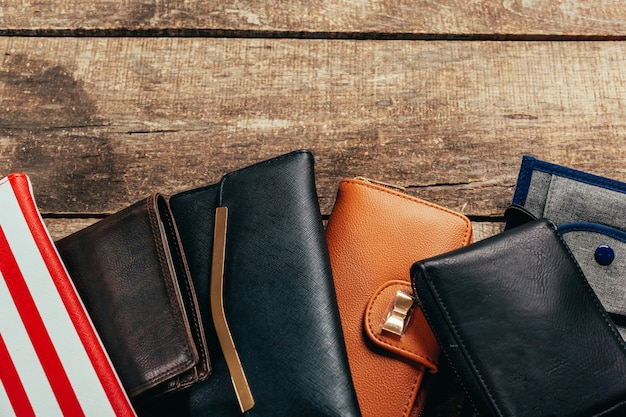 Wallets on wooden background
