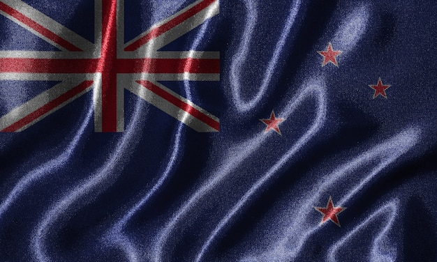 ファブリックでニュージーランドの旗と波打ち際の旗の壁紙。
