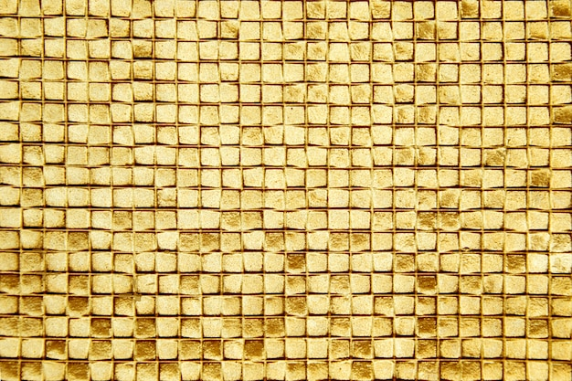 The walls are decorated with gold of tiles, texture background