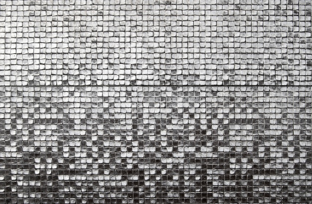 The walls are decorated with silver of tiles, texture background