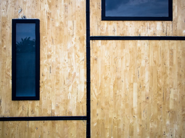 The walls are made from scrap wood panels