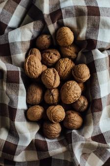 Walnut at Organic Farmer's Market. Group of organic walnuts on towel