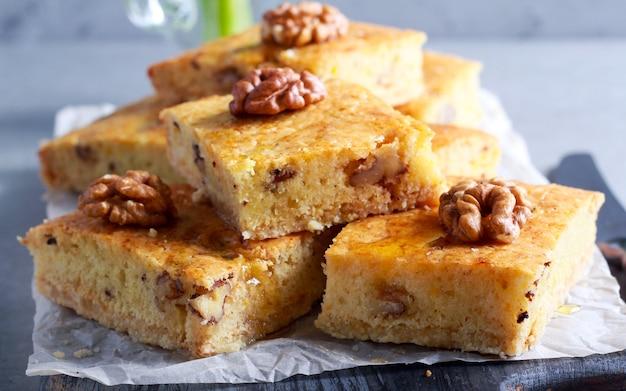 Walnut and honey cake, sliced on board