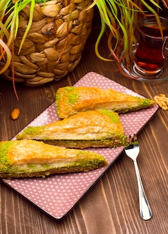 Walnut, pistachio turkish style antep baklava presentation and service