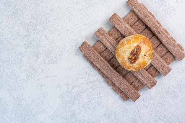 Walnut and stick biscuits on gray background. high quality photo