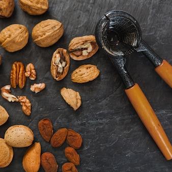 Walnuts, almonds and nutcracker