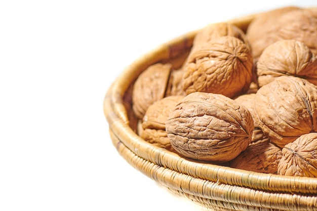 Walnuts in a basket isolated on white