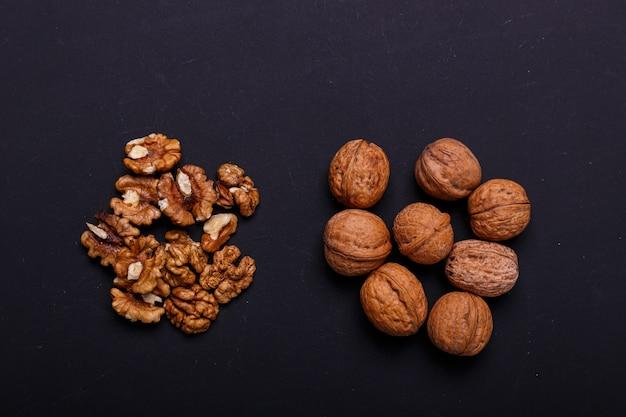 Walnuts on a black slate - healthy snack.