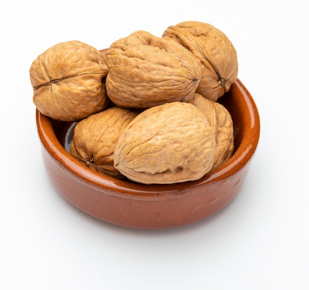 Walnuts in clay bowl (various nuts collection). isolated