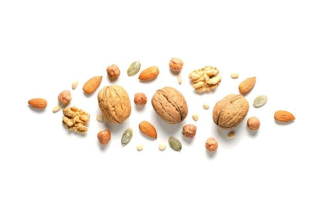 Walnuts, hazelnuts and almonds on a white background. healthy eating. flat top view.