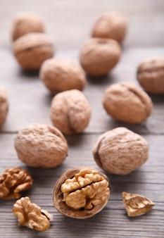 Walnuts kernels on grey wooden background. walnut healthy food