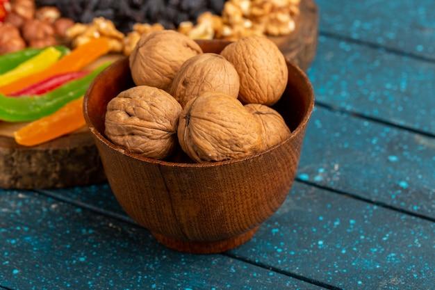 Walnuts and marmalade on blue