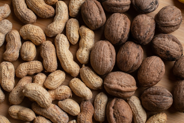 Walnuts and nuts on the wooden background
