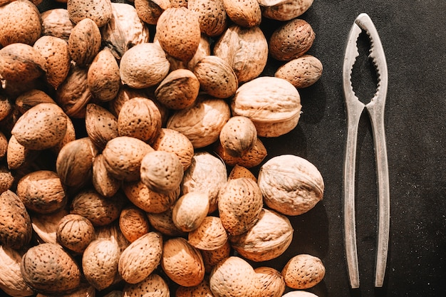 Walnuts in shells and nut mill