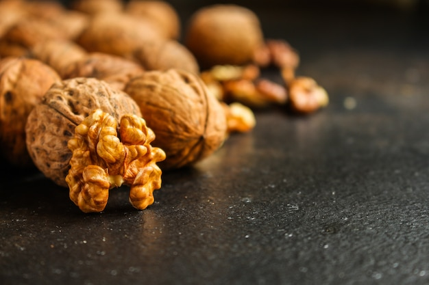 Walnuts, tasty and healthy (kernels, whole nuts) menu . food background. copyspace. top view