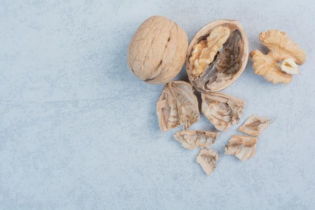 Walnuts and walnut kernels on blue background. high quality photo