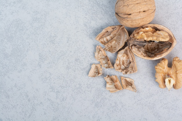 Walnuts and walnut kernels on blue background. high quality photo