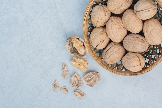 Walnuts and walnut kernels in ceramic bowl. high quality photo