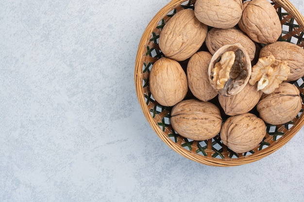 Walnuts and walnut kernels in ceramic bowl. high quality photo