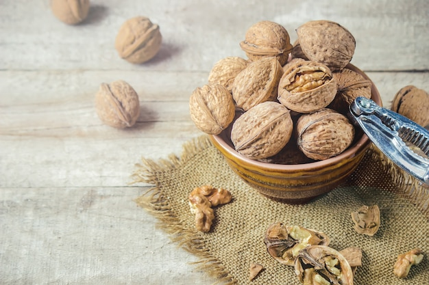 Walnuts on wooden background. selective focus.