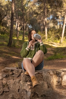 Wanderlust nature concept with female traveler