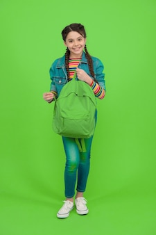 For the wanderlust in you. happy kid hold backpack green background. traveling and wanderlust. wander and discover. wanderlust concept. summer vacation. adventure and discovery. school holidays.