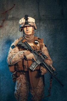 War, army, weapon concept. private military contractor holding rifle