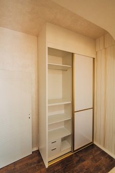 Wardrobe in the apartment interior design