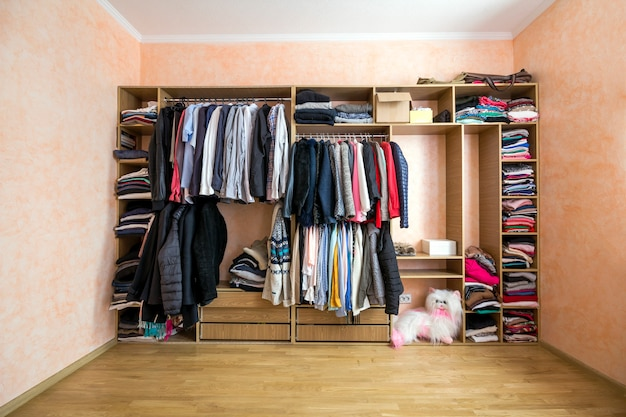 Wardrobe full of different men and woman clothes