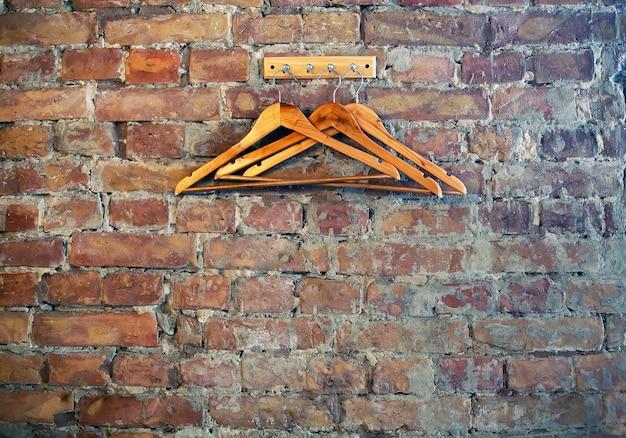 Wardrobe hangers at bricks wall