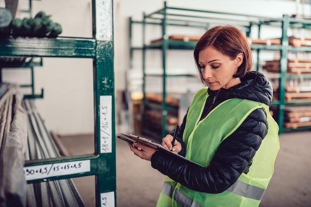 Warehouse clerk signing document