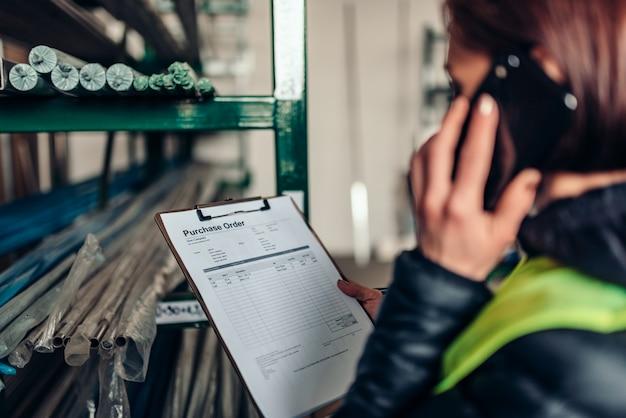Warehouse clerk using phone