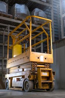 Warehouse loader, lift machine  in warehouse interior